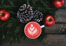 Free 3 Apples And 2 Pine Cones With Cup Of Drink On Table Royalty Free Stock Photography - 83020127