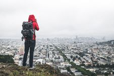 Free Hiker On Hill Above City Stock Photo - 83020420