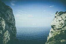 Free Steep Rocky Cliffs On Coastline Stock Photography - 83020552