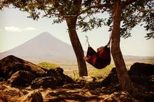 Free Person Lying On Black And Red Hammock Beside Mountain Under White Cloudy Sky During Daytime Royalty Free Stock Images - 83021119