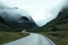 Free Winding Road Through Mountain Fog Royalty Free Stock Image - 83021526