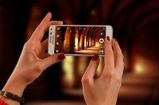 Free Woman Holding A White Samsung Galaxy Android Smartphone Taking A Photo Of Hallway Stock Images - 83022534