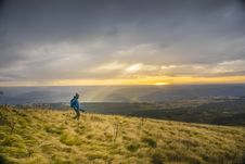 Free Hiker In Field At Sunset Royalty Free Stock Image - 83023266