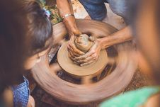 Free Person Making Clay Pot In Front Of Girl During Daytime Stock Photography - 83024022