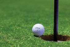 Free Titrist Golf Ball Near Golf Hole Royalty Free Stock Photos - 83024338