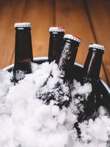 Free Bottles In Ice Stock Photos - 83024393