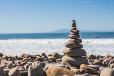Free Tower Of Stones Pebbles And Rock Near Sea Shore Under The Bright Sky During Daytime Royalty Free Stock Photography - 83024627