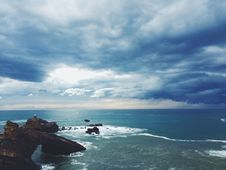 Free Clouds Over Rocky Coast  Stock Images - 83025294