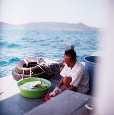 Free Man Wearing White Shirt Doing Laundry On Red Basin Stock Image - 83025331