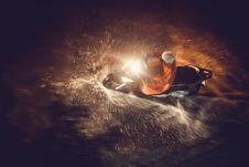 Free Motorcycle Splashing Through Puddle Stock Image - 83035501