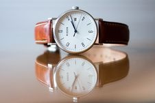 Free Wristwatch On Glass Tabletop Stock Photography - 83035572