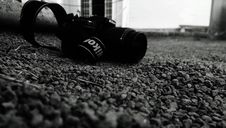 Free Nikon Camera On Pebbles Stock Image - 83035601