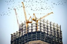 Free Tower Crane On Top Of Building Stock Image - 83036031