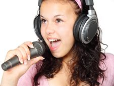 Free A Girl Holding A Microphone With A Headphone Royalty Free Stock Images - 83036399