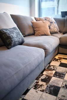Free Comfortable Grey Couch With Pillows Royalty Free Stock Photo - 83036435