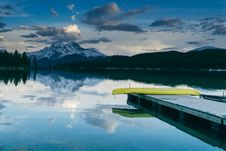 Free Pier And Lake With Mountains In Distance Stock Photos - 83036983