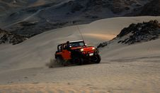 Free Red Jeep Wrangler On White Covered Field Royalty Free Stock Photography - 83037077