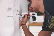 Free Man Writing On Whiteboard Royalty Free Stock Image - 83037186