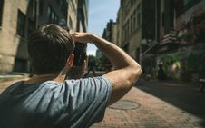 Free Young Man Looking Down The Street Royalty Free Stock Photos - 83037418