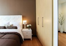 Free White Bed Next To White Accent Table Stock Photo - 83037450