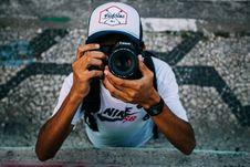 Free Man Wearing White Nike Sb Shirt Holding Black Dslr Camera Stock Image - 83037511