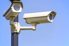 Free White 2 Cctv Camera Mounted On Black Post Under Clear Blue Sky Royalty Free Stock Images - 83037749