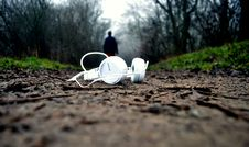 Free White Earphones On Brown Mud Floor Royalty Free Stock Photography - 83038047
