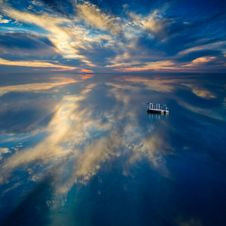 Free Sunset And Clouds Reflecting In Blue Waters Stock Photos - 83038123