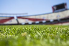 Free Green Grass Across Beige Red Open Sports Stadium During Daytime Stock Photos - 83038193