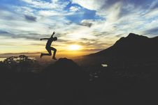Free Hiker Jumping Against Setting Sun Stock Photography - 83038562