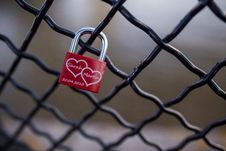 Free Red And Stainless Steel 2 Hearts Padlock On Black Cyclone Fence During Daytime Royalty Free Stock Image - 83038606
