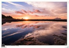 Free Sunset Over Coastline Stock Image - 83039711