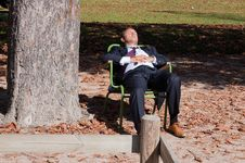 Free Businessman In Lawn Chair Stock Photos - 83054253