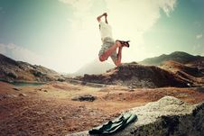 Free Man Jumping In Mountains Stock Images - 83057664
