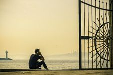 Free Man Sitting At Harbor Royalty Free Stock Photography - 83057777