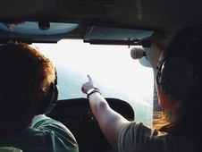 Free Persons On Aircraft Pointing On View During Daytime Stock Photos - 83057803