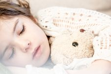 Free Girl Sleeping With Her Brown Plush Toy Stock Photo - 83057840
