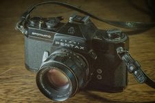 Free Black Pentax Digital Camera On Brown Surface Royalty Free Stock Photos - 83057938