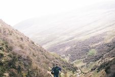 Free Man Hiking In The Mountains Royalty Free Stock Image - 83057976