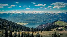 Free Green Pine Trees Near Lake Under White Clouds And Blue Sky During Daytime Royalty Free Stock Photos - 83057998