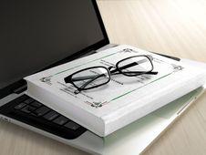 Free Black Frame Eyeglasses On White Book Royalty Free Stock Photo - 83058015