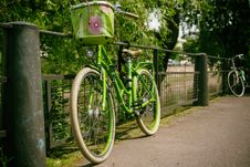 Free Green Commuter Bike Park In A Green Metal Grill Royalty Free Stock Photography - 83058017