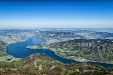 Free Aerial Photo Of River Between Green Mountain Under Clear Blue Sky Royalty Free Stock Image - 83058036