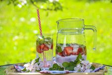 Free Clear Glass Pitcher With Water And Strawberry Stock Photography - 83058042