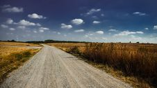 Free Gray Road In Between Brown Grass Under White Cloudy Sky Royalty Free Stock Photography - 83058137