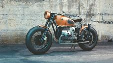 Free Orange And Black Bmw Motorcycle Before Concrete Wall Royalty Free Stock Photo - 83058395