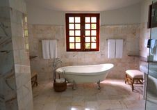 Free White Bathtub On White Tile Bathroom Near Brown Framed Clear Glass Window Stock Photos - 83058633