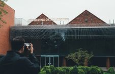 Free Man Taking Picture Of Brown Green Building During Daytime Royalty Free Stock Images - 83058929