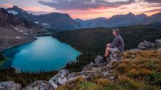 Free Person Sitting On Gray Rocks During Sunset Royalty Free Stock Photo - 83059115