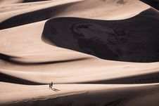 Free Tow Person Walking On Sand Dunes At Daytime Stock Image - 83059231